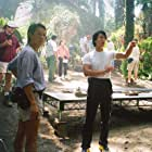 Giving out instructions to crew members in Malaysian jungle set