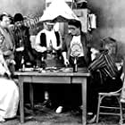 L-R Sitting, Kurt Russell, three extras, Standing, Paul J.Q. Lee, Sitting,