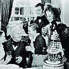 June Lockhart, Lynne Carver, Terry Kilburn, Barry MacKay, and Reginald Owen in A Christmas Carol (1938)