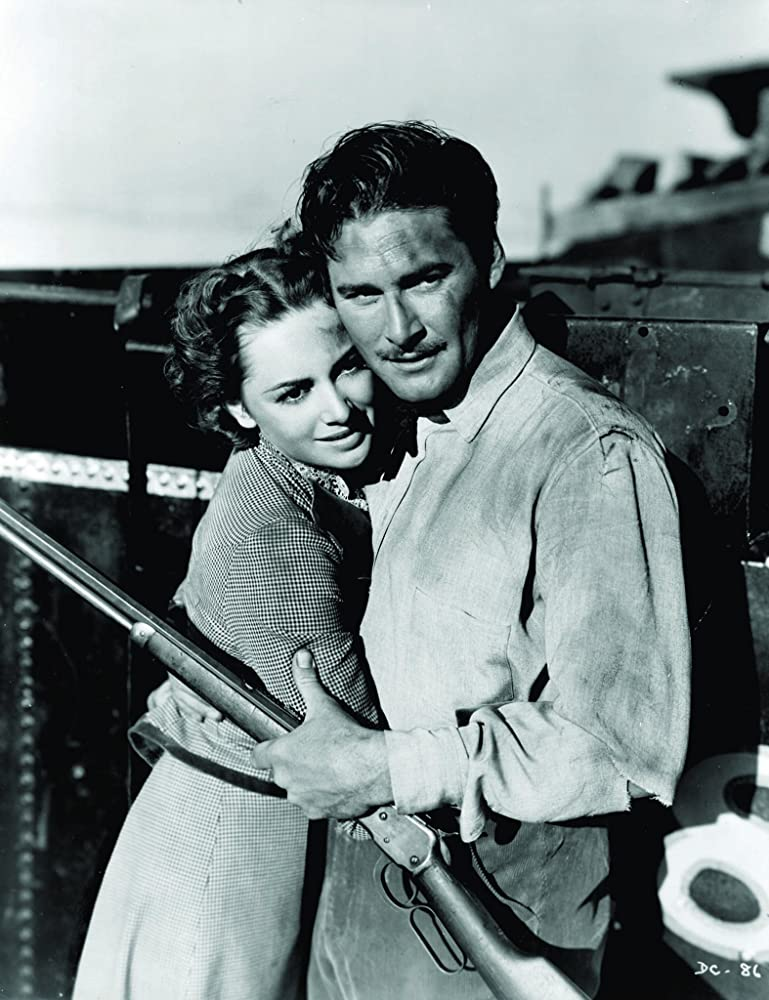 Olivia de Havilland and Errol Flynn in Dodge City (1939)
