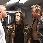 Bill Goldberg (appearing as himself) and Page Falkinburg (appearing as Diamond Dallas Page) with Joe Pantoliano (appearing as Titus Sinclair) caught in the middle