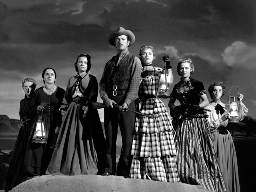 Robert Taylor, Julie Bishop, Denise Darcel, Beverly Dennis, Hope Emerson, Marilyn Erskine, and Lenore Lonergan in Westward the Women (1951)
