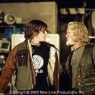 Scud (Norman Reedus, left) and Whistler (Kris Kristofferson) debate in New Line Cinema's action thriller, BLADE II.