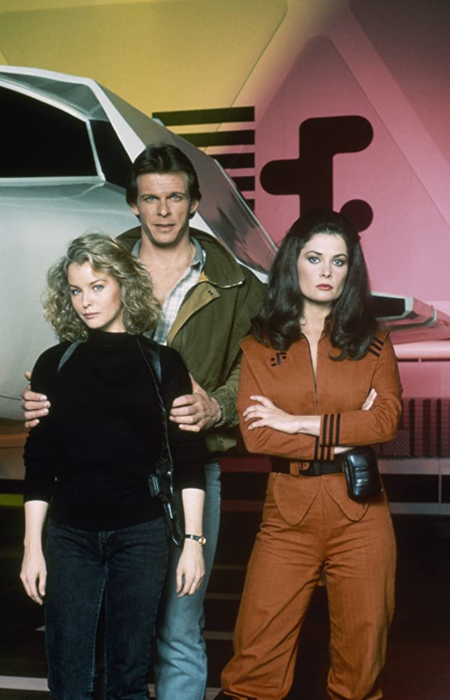 Jane Badler, Marc Singer, and Faye Grant in V (1984)