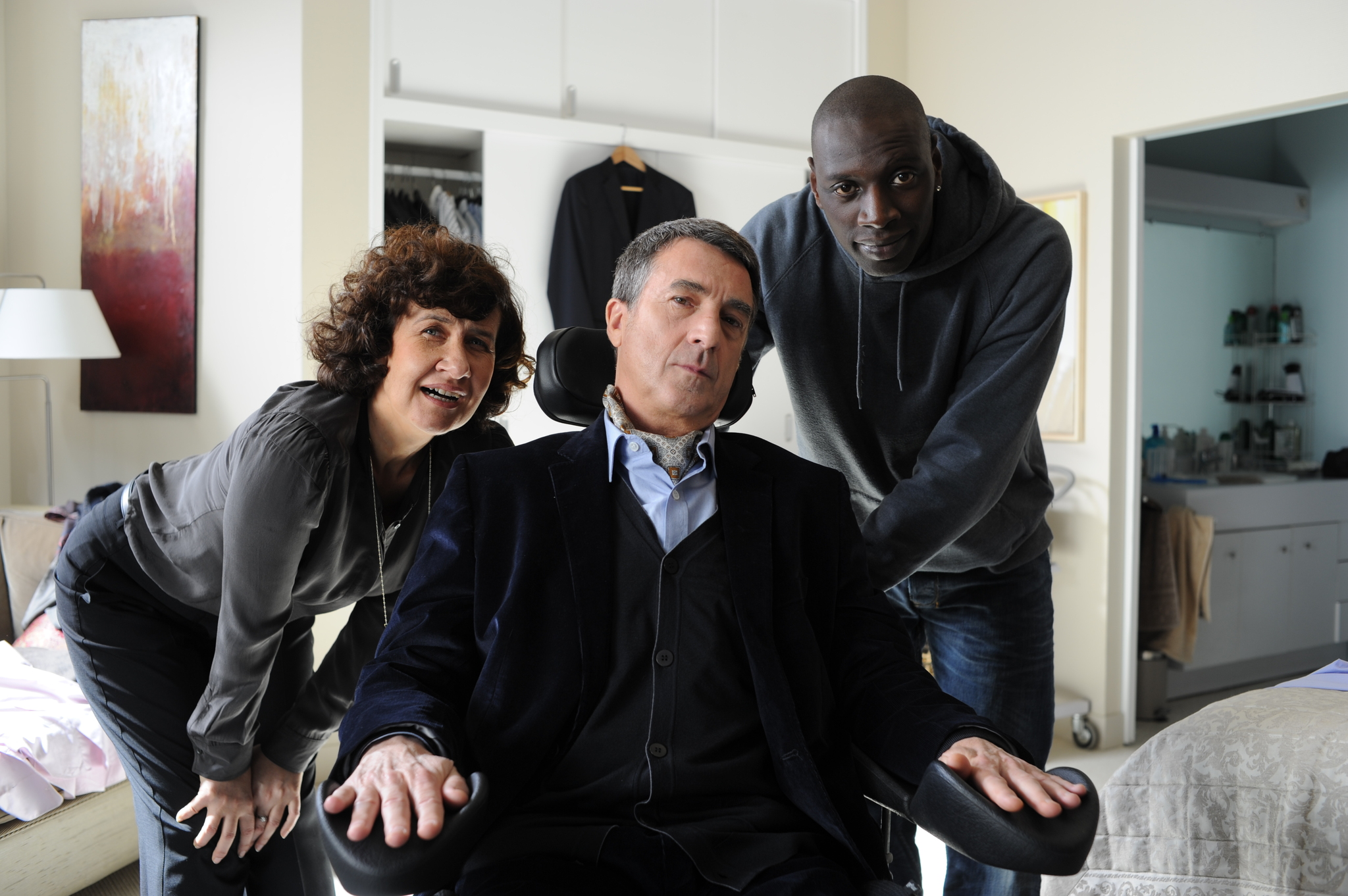 François Cluzet, Anne Le Ny, and Omar Sy in Intouchables (2011)