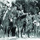 John Wayne, Robert Barrat, Wilfrid Lawson, and Chill Wills in Allegheny Uprising (1939)