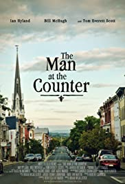 The Man at the Counter Poster