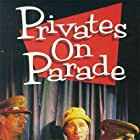 John Cleese, Michael Elphick, Joe Melia, and Denis Quilley in Privates on Parade (1983)