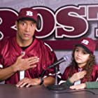 Dwayne Johnson and Madison Pettis in The Game Plan (2007)