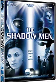 Sherilyn Fenn and Dean Stockwell in The Shadow Men (1997)