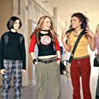 Anna (Lindsay Lohan, center) hangs out with best friends Peg (Haley Hudson, left) and Maddie (Christina Vidal, right) at school.