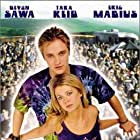 Devon Sawa and Tara Reid in Around the Fire (1998)