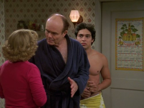 Kurtwood Smith, Wilmer Valderrama, and Debra Jo Rupp in That '70s Show (1998)
