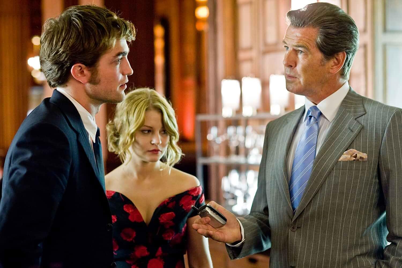 Pierce Brosnan, Emilie de Ravin, and Robert Pattinson in Remember Me (2010)