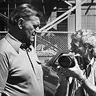 "John Wayne and photographer David Sutton on the set of ""McQ"""