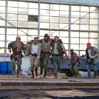 Dolph Lundgren, Sylvester Stallone, Wesley Snipes, Jason Statham, Terry Crews, and Randy Couture in The Expendables 3 (2014)