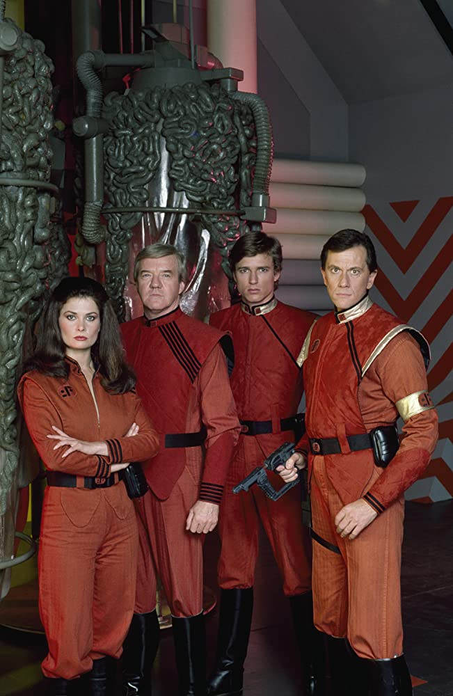 Jane Badler, Richard Herd, Peter Nelson, and Andrew Prine in V: The Final Battle (1984)