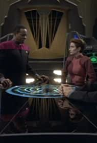 Terry Farrell, Nana Visitor, Avery Brooks, and Alexander Siddig in Star Trek: Deep Space Nine (1993)