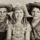 Jackie Coogan, Junior Durkin, and Mitzi Green in Tom Sawyer (1930)