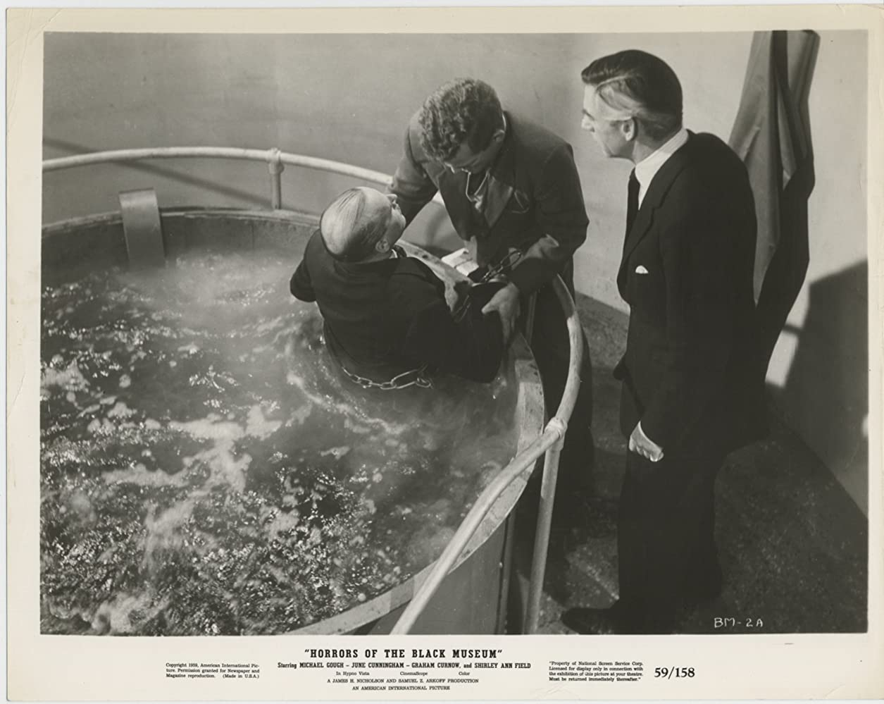 Michael Gough, Gerald Andersen, and Graham Curnow in Horrors of the Black Museum (1959)