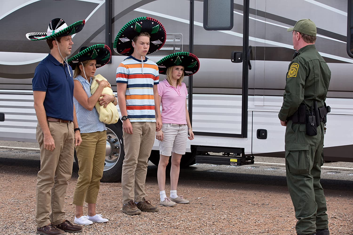 Jennifer Aniston, Emma Roberts, Jason Sudeikis, and Will Poulter in We're the Millers (2013)