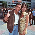 Jean-Claude Van Damme and Darcy LaPier at an event for The Quest (1996)