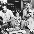 John Travolta, Kelly Lynch, and Andrew Lawrence in White Man's Burden (1995)