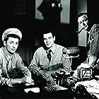Robert Mitchum, Robert Young, and Robert Ryan in Crossfire (1947)