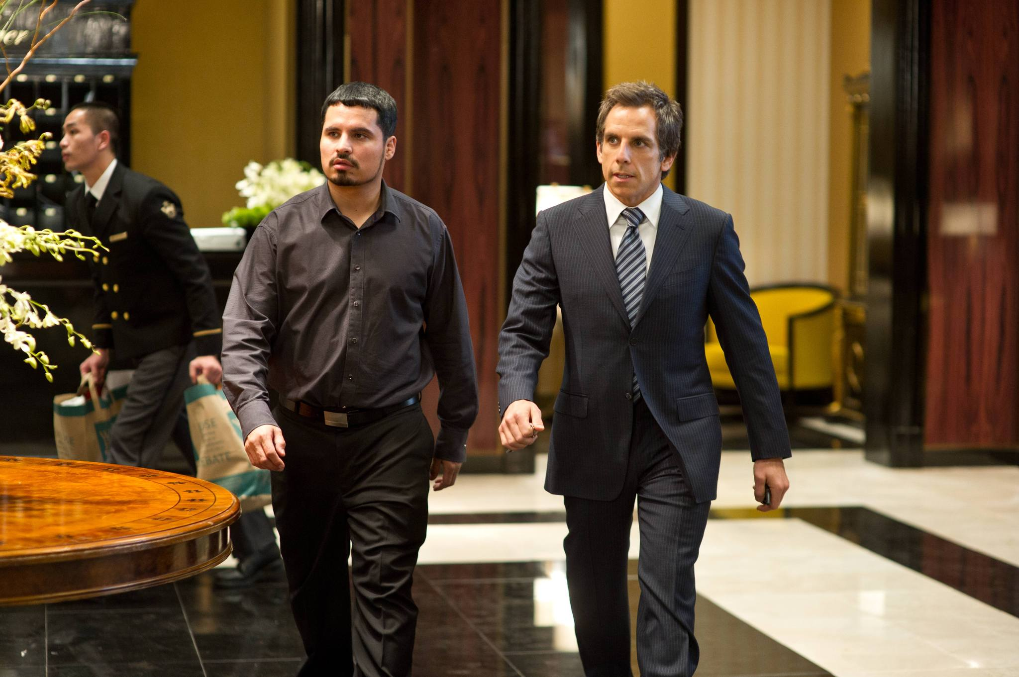 Ben Stiller and Michael Peña in Tower Heist (2011)