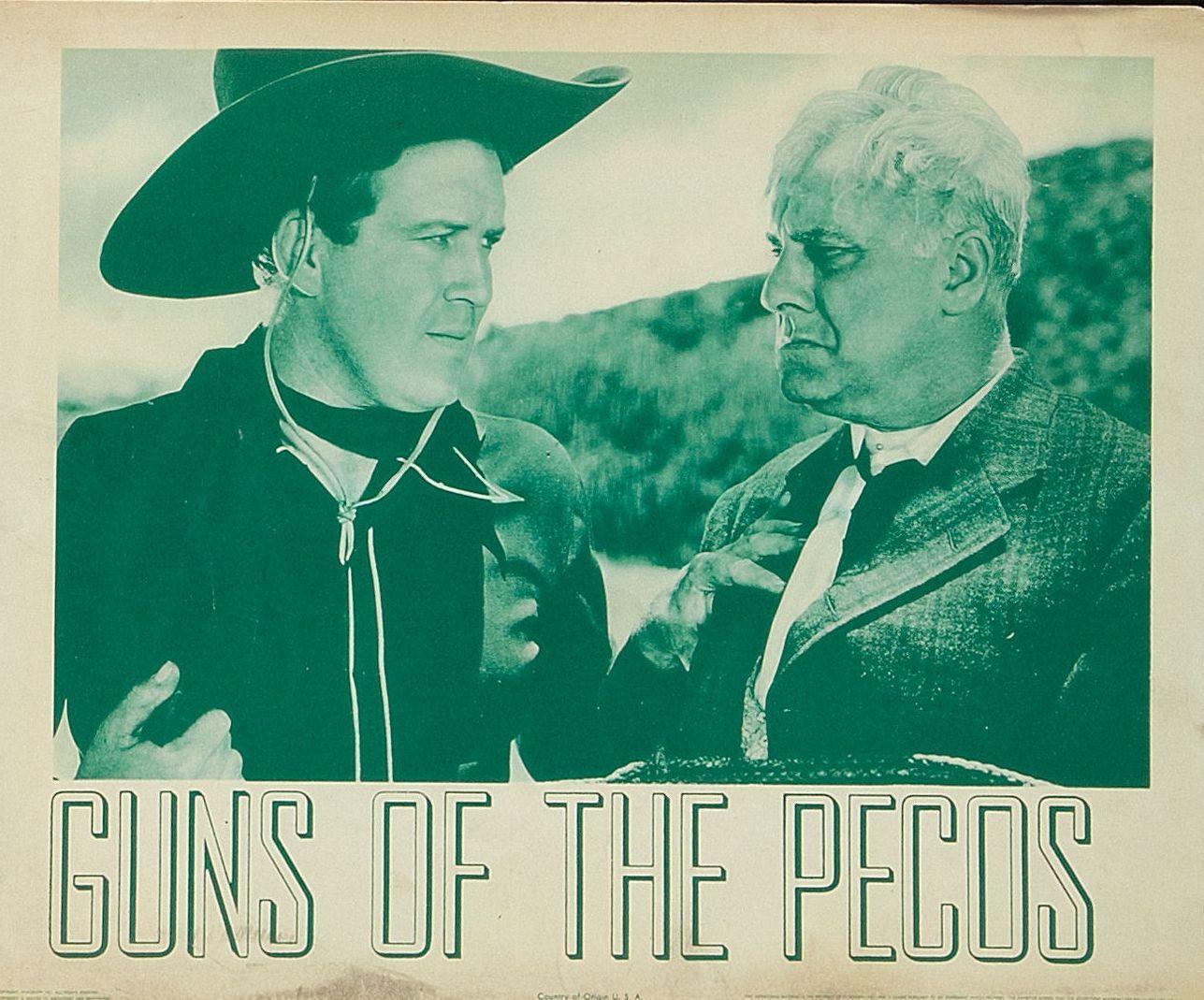 Dick Foran and Robert Middlemass in Guns of the Pecos (1937)