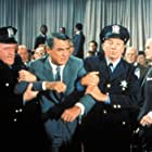 Cary Grant, Ken Lynch, and Patrick McVey in North by Northwest (1959)