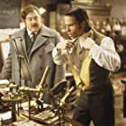 Guy Pearce and Mark Addy in The Time Machine (2002)