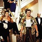 Jim Carrey, Michael Reid MacKay, and Kristin Norton in Ace Ventura: When Nature Calls (1995)
