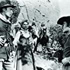 Errol Flynn, Scott Forbes, and Patrice Wymore in Rocky Mountain (1950)
