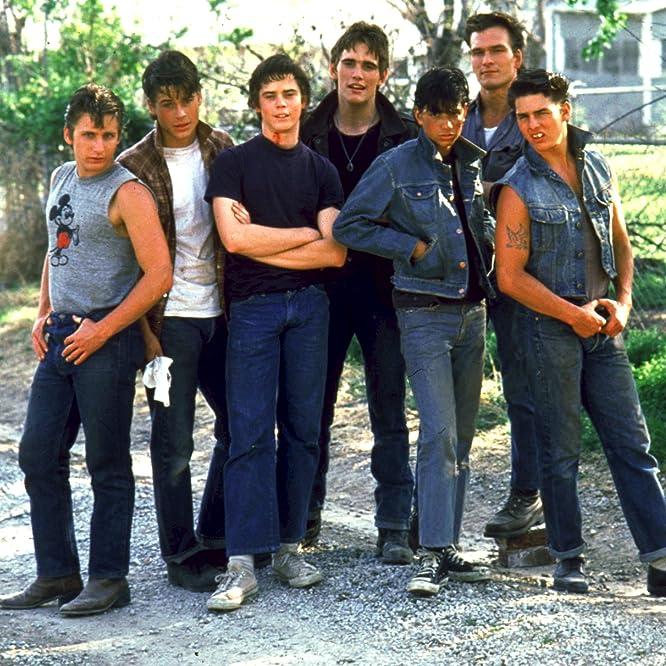 Tom Cruise, Matt Dillon, Emilio Estevez, Rob Lowe, Patrick Swayze, C. Thomas Howell, and Ralph Macchio in The Outsiders (1983)