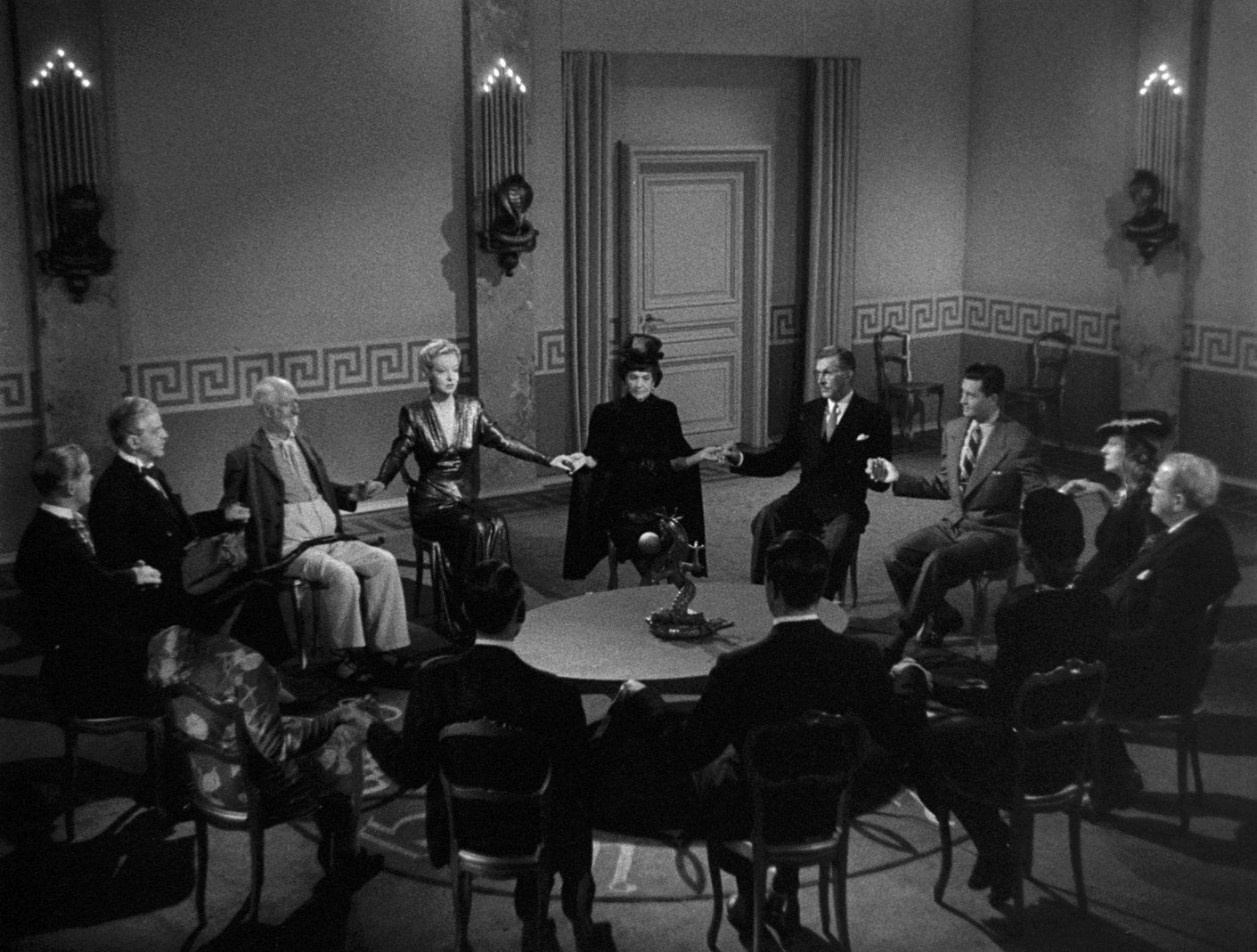 Ray Milland, Dan Duryea, Hillary Brooke, Carl Esmond, Mary Field, and Alan Napier in Ministry of Fear (1944)