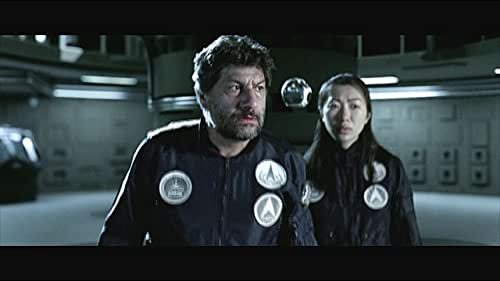 Two strangers must band together to discover who marooned them in space and why.