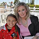 """Caitlin Carmichael and Morgan Fairchild on set of """"Wiener Dog Nationals"""" July 2012"""