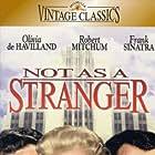 Olivia de Havilland, Robert Mitchum, and Frank Sinatra in Not as a Stranger (1955)