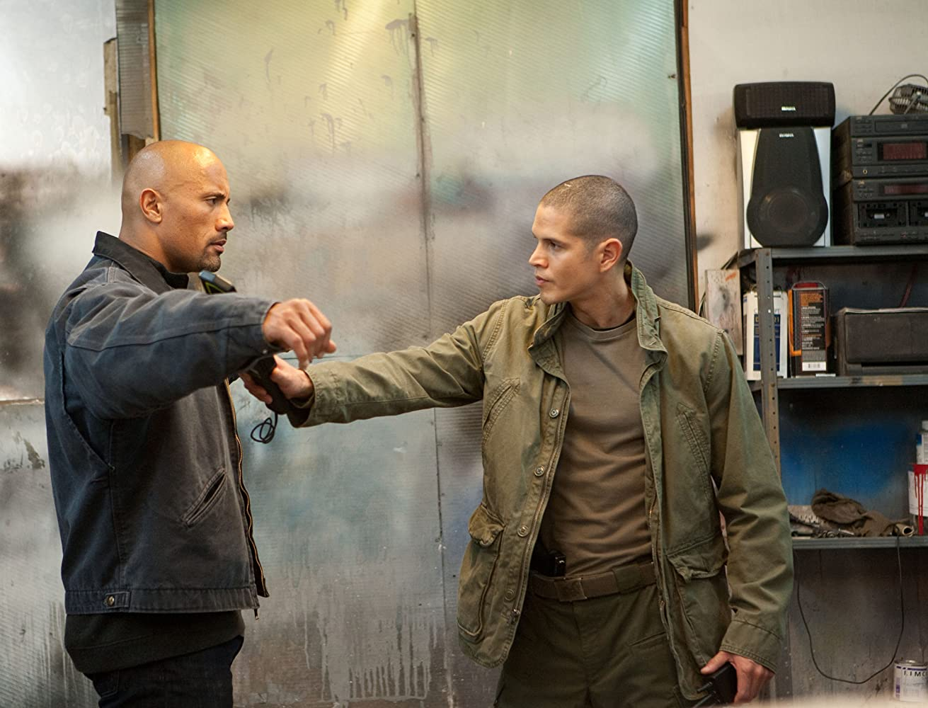 Dwayne Johnson and JD Pardo in Snitch (2013)