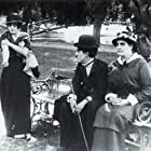 Charles Chaplin, Phyllis Allen, and Mabel Normand in His Trysting Place (1914)