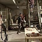 Norman Reedus, Melissa McBride, and Steven Yeun in The Walking Dead (2010)