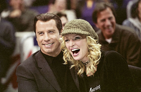 JOHN TRAVOLTA and UMA THURMAN star as Chili Palmer and Edie Athens in MGM Pictures' comedy BE COOL.