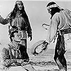 John Wayne, Rodolfo Acosta, and Michael Pate in Hondo (1953)