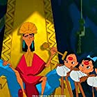 Emperor Kuzco stamps kiss marks on babies instead of kissing them