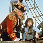 Sarah Polley and John Neville in The Adventures of Baron Munchausen (1988)
