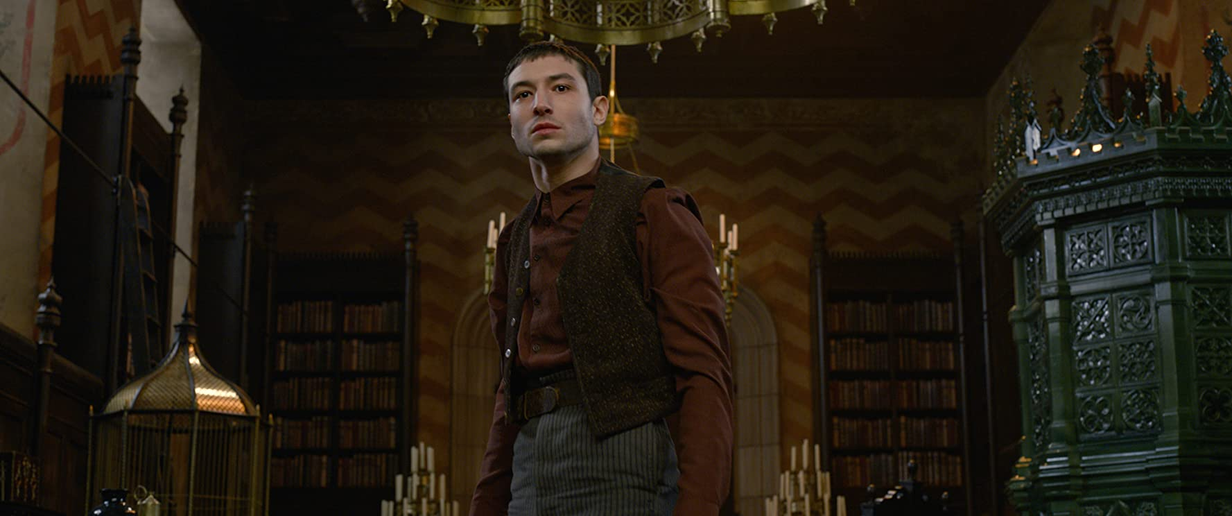 "Credence RevivalEzra Miller (/name/nm3009232) returns as Credence, a young man once believed to be non-magical but found to have developed an Obscurus (a dark parasitical magical force). Credence has come to Paris, where he is desperately searching for his real mother, hoping to learn his true identity. Taking a break from filming, Miller said: ""He's a bit of a ticking time bomb, given his particular magical condition. But he has a burning need to know more about who he actually is... so he's on this quest for identity."" He added: ""What I think is interesting in the story of Credence is that he has been betrayed and mistreated by both worlds at this point. He has been mistreated by folks in the wizarding world, and muggle folks as well, so I think there a great skepticism of everyone he sees."""