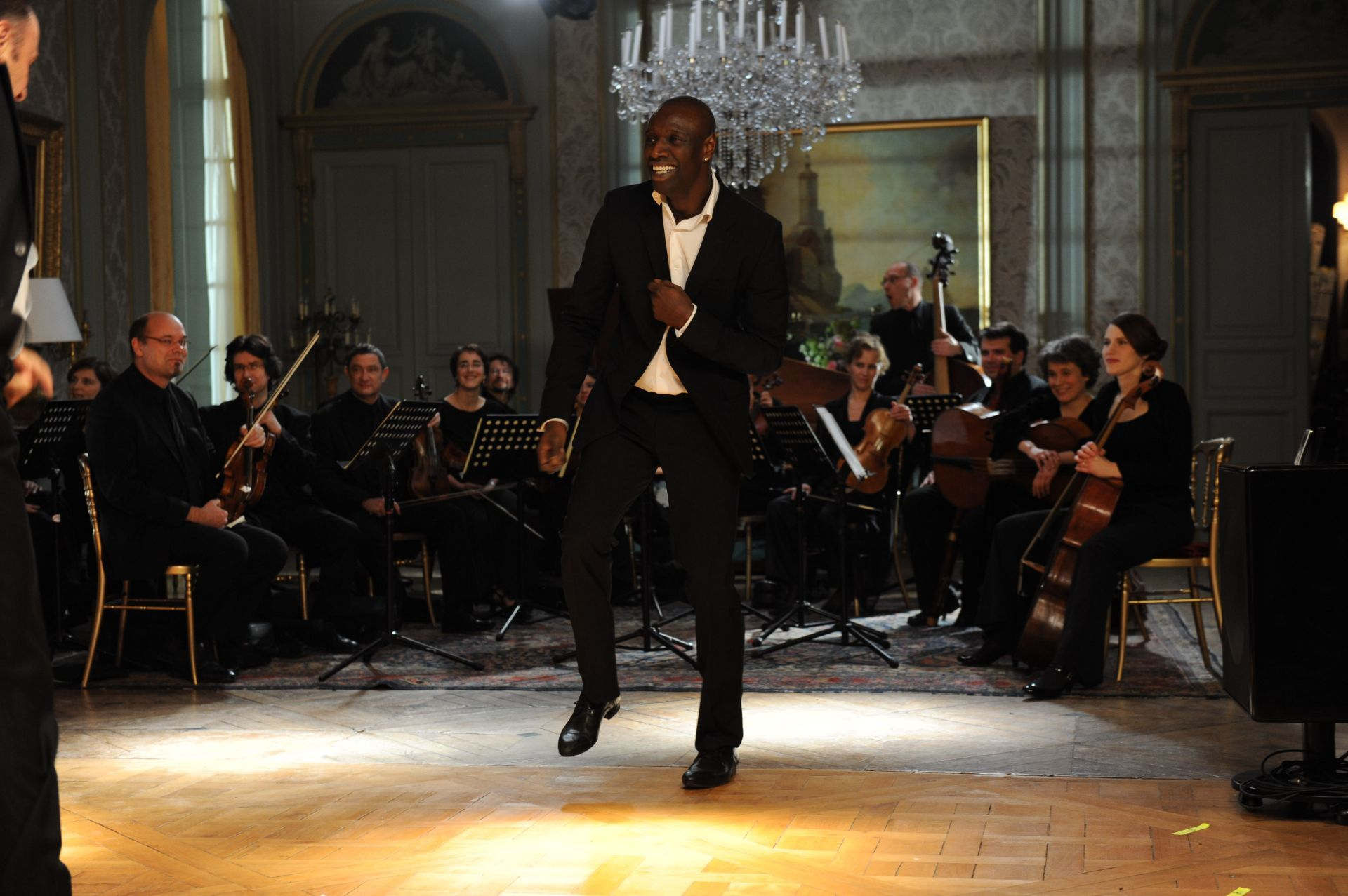 Omar Sy, Le Capriccio Français, and Philippe Le Fevre in Intouchables (2011)