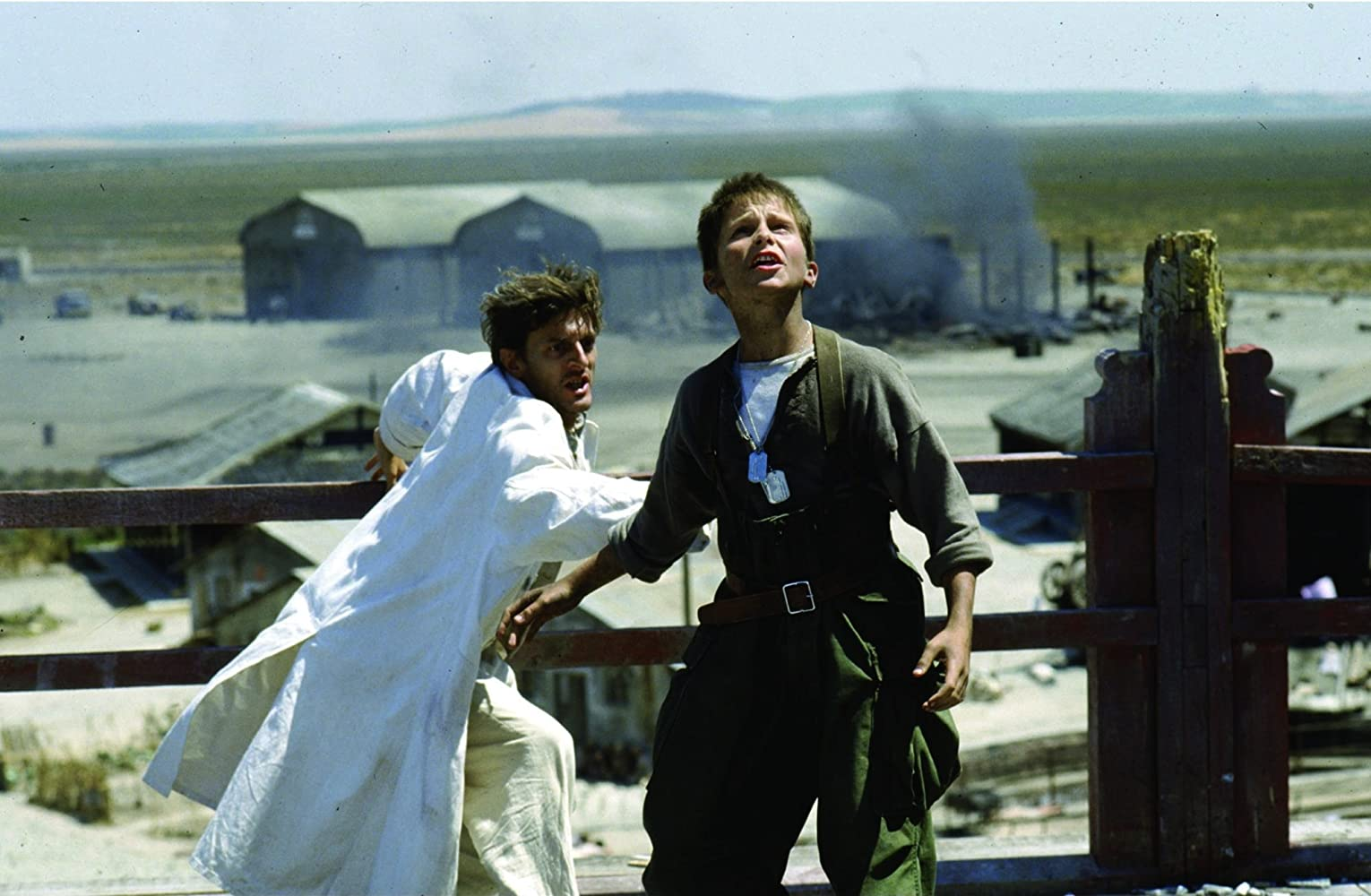 Christian Bale and Nigel Havers in Empire of the Sun (1987)