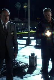 Paul Guilfoyle and William Petersen in CSI: Crime Scene Investigation (2000)